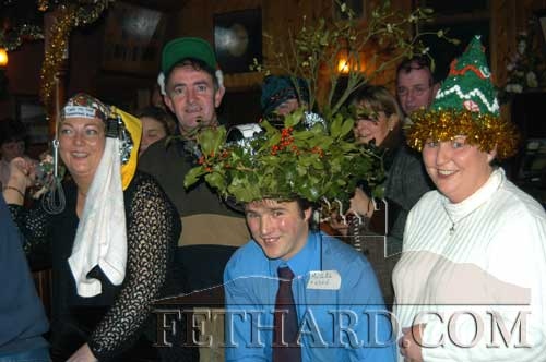 L to R: Philomena Shea, Phil Shea, Brendan Morrissey and Joan Carroll photographed at the Christmas Hat Party run at the Bridge Bar Fethard in aid of the CRC Santa Bear Appeal.