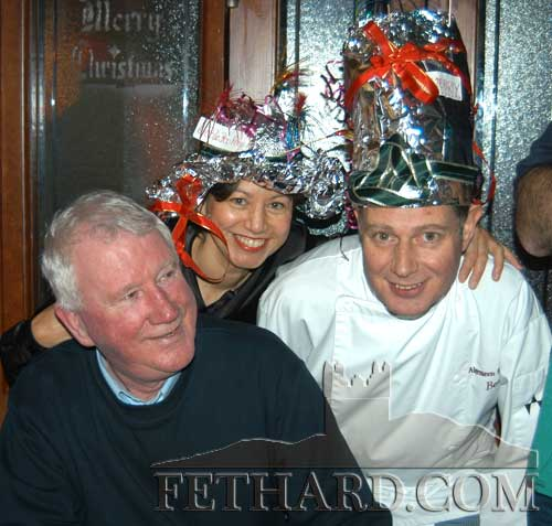 Photographed at the Christmas Hat Party run at the Bridge Bar Fethard in aid of the CRC Santa Bear Appeal are L to R: Austin O'Flynn, Janneke and Bert van Dommelen. December 14, 2002.