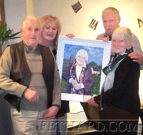 Local artist, Marie O'Hara, presenting Alice Leahy with a portrait she painted to mark Alice's work with the homeless in Dublin for the past 40 years. L to R: Charlie Best, Marie O'Hara, Donal Leahy and Alice Leahy.