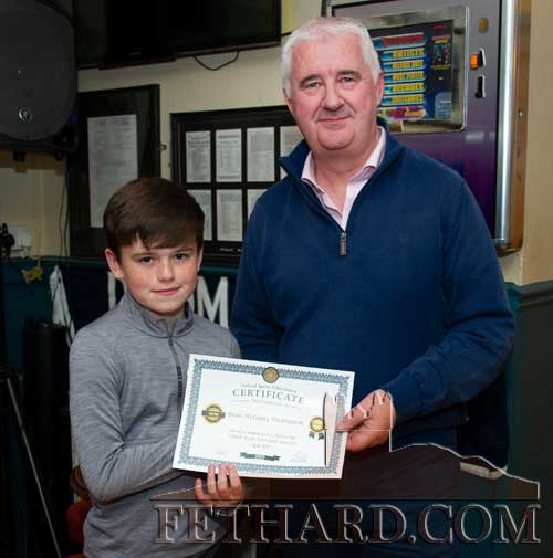 Young archer Sean McGarry Thompson receiving his nomination certificate from Paul Guinan. Sean continues his winning ways in the world of Archery with a good win at Ashgrove Co Cork.