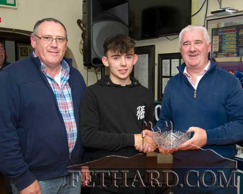 Local angler Robert Hackett, winner of the Juvenile All Ireland River Fly Fishing title on the Clare River in Co. Galway, receiving the overall Sports Achievement Award for April from Paul Guinan (right), representing this month's award sponsor Cox's Cash & Carry, Thurles. Also included is winner of the 'Mentor of the Month' award Paul Shanahan (left).