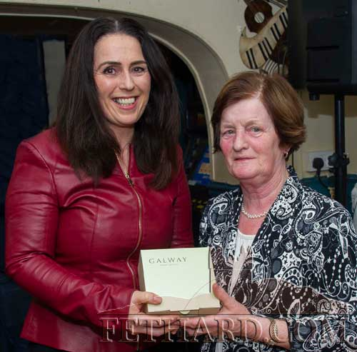 Mary Godfrey (right), representing the selection committee, presenting the 'Mentor of the Month' Award to Mia Treacy, coach with St. Rita's Camogie Club.