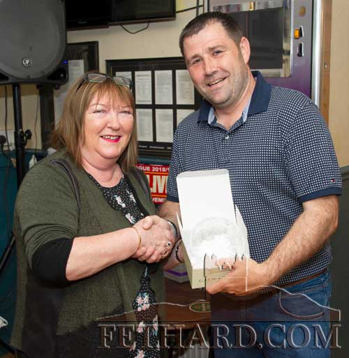 Anne Butler, representing this months sponsor, Butler's Sports Bar, presenting the 'Mentor of the Month' award to Eugene Walsh. Eugene has spent over thirty-five years between playing and coaching with Fethard GAA Club.