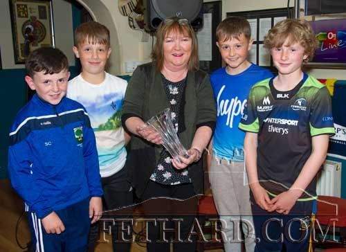 Anne Butler, representing this months sponsor, Butler's Sports Bar, presenting the Butler's Bar Fethard Sports Achievement Awards for May to Fethard U12 A Football Team, winners of both South and County A titles for the first time in the history of the club. The award was accepted by team members L to R: Sam Coen, Gavin Neville, Anne Butler (sponsor), Charlie Walsh and Noah O'Flynn.
