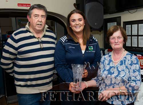 Edel Fitzgerald receiving the Butler's Bar Sports Achievement Award on behalf of the St. Rita's Junior Camogie Team, from Philip Butler (proprietor) and Mary Godfrey, representing this month's sponsor J.C. Kenny Wine Distributors, Galway.