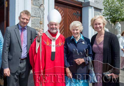 Archbishop Kieran O'Reilly with members of the Ponsonby family, Grove, Fethard. L to R: Julian Ponsonby, Archbishop Kieran O'Reilly, Rosemary Ponsonby and Patricia  Ponsonby. Rosemary Ponsonby and her son Julian brought the keys of the church  to the altar of gifts during the Mass, representing various aspects of the church's history, and recollecting the donation of the church site by their ancestor William Barton, the Protestant landlord of the time, who also donated 100 guineas towards building costs.