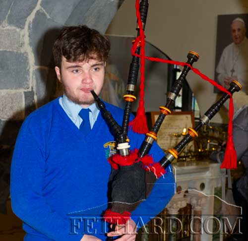 Patrician Presentation Secondary School student, Ned Looby Ryan, playing a selection of beautiful seasonal music on his bagpipes at the 'unofficial' opening of the Christmas Crib in the Augustinian Abbey.