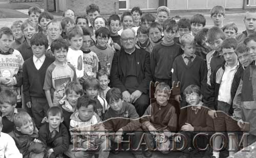 Br. Raymond Forde, principal of St. Patrick's National School Fethard, pictured with pupils on his last day teaching in Fethard on June 30, 1993.  Br. Raymond's retirement marks the end of 120 years of the Patrician Brothers association with the town.