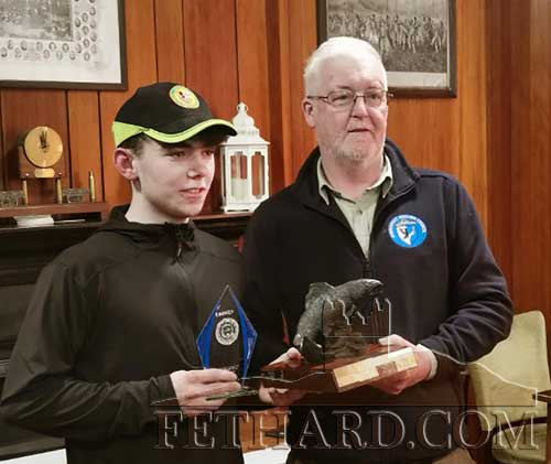 All Ireland 2018 River juvenile fly-fishing champion, Robert Hackett (left), receiving his trophy from Eugene Nolan from Tuam Anglers.