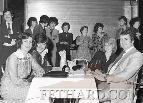 Clonmel Arms Hotel on 21st February, 1979. A lot of the Five Star staff and friends in the background holding up the bar including Frank Carroll, Joe Carroll (Ardfinnan), Mary Carroll (Fethard), Mary Casey, Frank Olney and Marianne Butler. The four sitting in front are L to R: Anne Bonelli, Alan Doyle, Marie Doyle and Gus Bonelli.