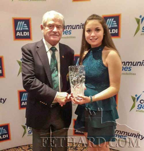 Amy Morrissey, Killusty, accepting the Youth Volunteer Award from Tony Lee, Deputy President of National Community Games, on behalf of the winner, Lucy Murphy, Rosegreen, who unfortunately was unable to attend the presentation at the Aldi National Community Games Awards held in Mount Wolseley Hotel, Carlow last week.. Lucy – a former community games competitor – has assisted with numerous events at area and county level. Lucy is a member of Fethard Ladies Rugby team and also a big help to her mum, Polly, in coaching the ladies teams.