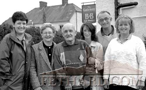 Pat O'Gorman (centre) pictured in Fethard after his family arranged a surprise visit to his native town. Pat worked at Rice's farm in Brookhill, Fethard, until he was 17 years of age, he then left for England and wasn't back home since. On his arrival met many of his old friends and neighbours and was also brought on a tour of the farm where he worked and the house where he lived. L to R: Mrs. Susan Carol Rogers, Pamela and Pat O'Gorman, Janice Maureen May (daughter), Dermot Rice, Brookhill, and Chris Nevin, proprietor of The Gateway B&B where he stayed while in Fethard. (Photograph taken May 26, 1994)