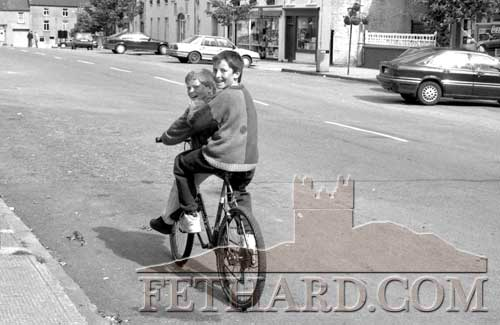 Two local lads on a bicycle made for two cycling on Main Street, Fethard on June 6, 1994