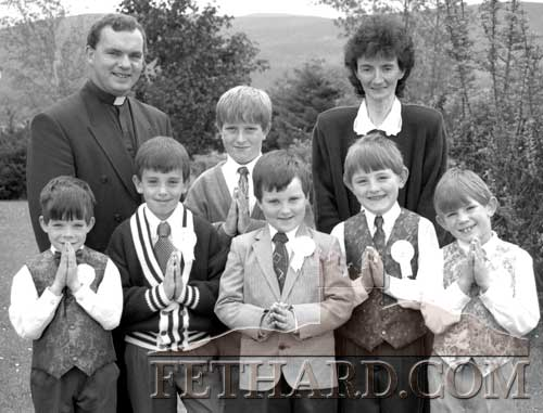 Fr. Denis Shanahan and Mrs Frances Harrington pictured with the six boys who received their First Holy Communion after Sunday Mass in Killusty on June 12, 1994.