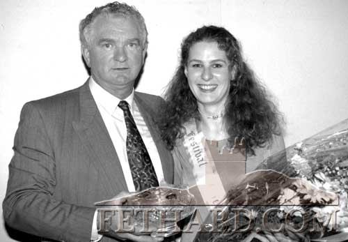 Community Council chairman Bernard Walsh presenting award and bouquet of flowers to Ann-Marie O'Meara, Fethard, who was chosen as the 1994 Festival Queen at the Fethard-Killusty London Reunion Festival Dance in Fethard Ballroom on June 24, 1994.