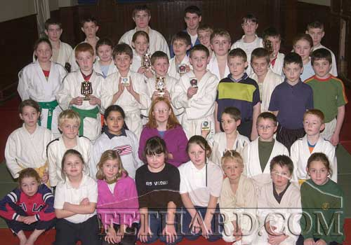 Members of Fethard Judo Club photographed with their recently won trophies at the club's training session in Fethard Town Hall in November 2001.