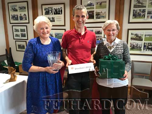 Club President, Noel O'Dwyer, presenting the 'President's Prize' to winners Bernie O'Meara and Anna Cooke (right) at Fethard Bridge Club's President's Prize Dinner.