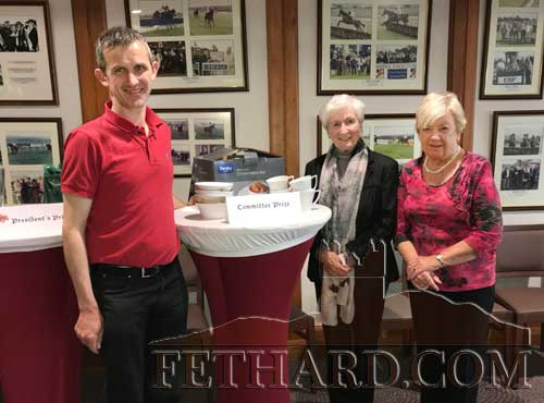 Club President, Noel O'Dwyer, presenting the 'Committee Prize' to winners Kay St. John and Rita Kane (right) at Fethard Bridge Club's President's Prize Dinner.