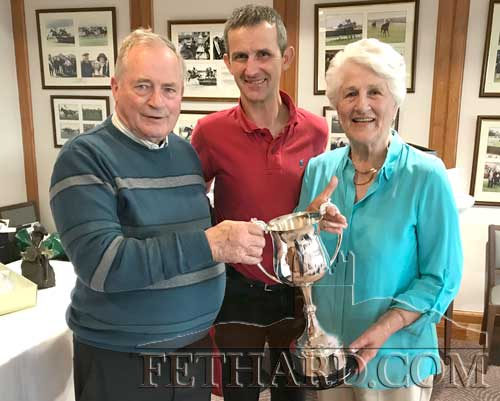 Club President, Noel O'Dwyer (centre), presenting the 'Club Championship' (Hayes Trophy) to winners Nell Broderick and David O'Meara.