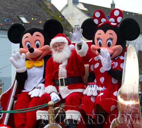 Santa arriving at The Square Fethard with his two friends, Minnie and Mikey Mouse