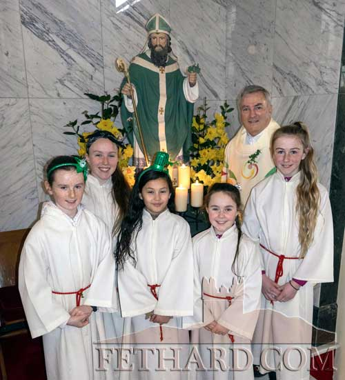 Fr Liam Everard P.P. photographed with altar servers after celebrating Mass on St. Patrick's Day in Holy Trinity Parish Church. L to R: Anna Hayes, Aoibheann Collum, Giovanna Aguiar Emily Spillane, Fr Liam Everard and Meadbh Collum.