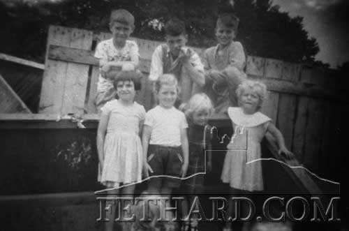 Sheila and Michael O'Donnell (Mary Flynn's children) photographed with Brendan Kenny, Don McCarthy, Marie Scanlon, Cathy Trehy and Norma Hanrahan playing in the wooden crates at the back of Mick Trehy's garage, July 1959.