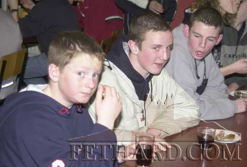 Tucking in at the Fethard Youth Club New Year Party in January 2002 are L to R: Tom Gilpin, Stephen O'Meara and Philip Ryan.