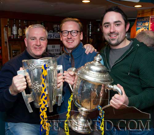 L to R: Riobard Broderick, Adam McLoughlin and Kevin O'Leary photographed with the Liam McCarthy Cup (Senior Hurling) and the Thomas Nolan Cup (U20 Hurling) at the Fethard Sports Achievement Awards.