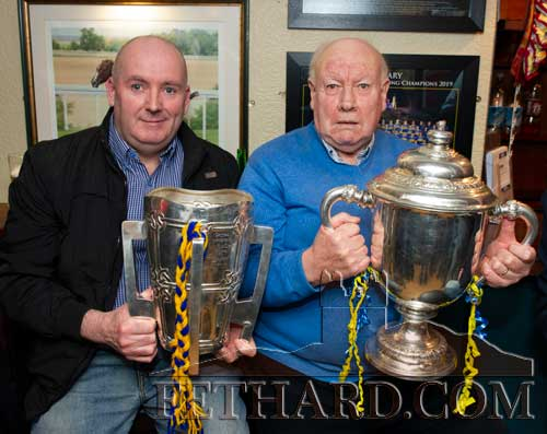 L to R: Francis Lonergan holding the Liam McCarthy Cup and Austy Godfrey holding the Thomas Nolan Cup.