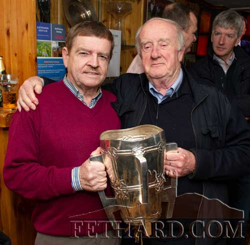 L to R: Brud Roche and Bill O'Sullivan photographed with the Liam McCarthy Cup