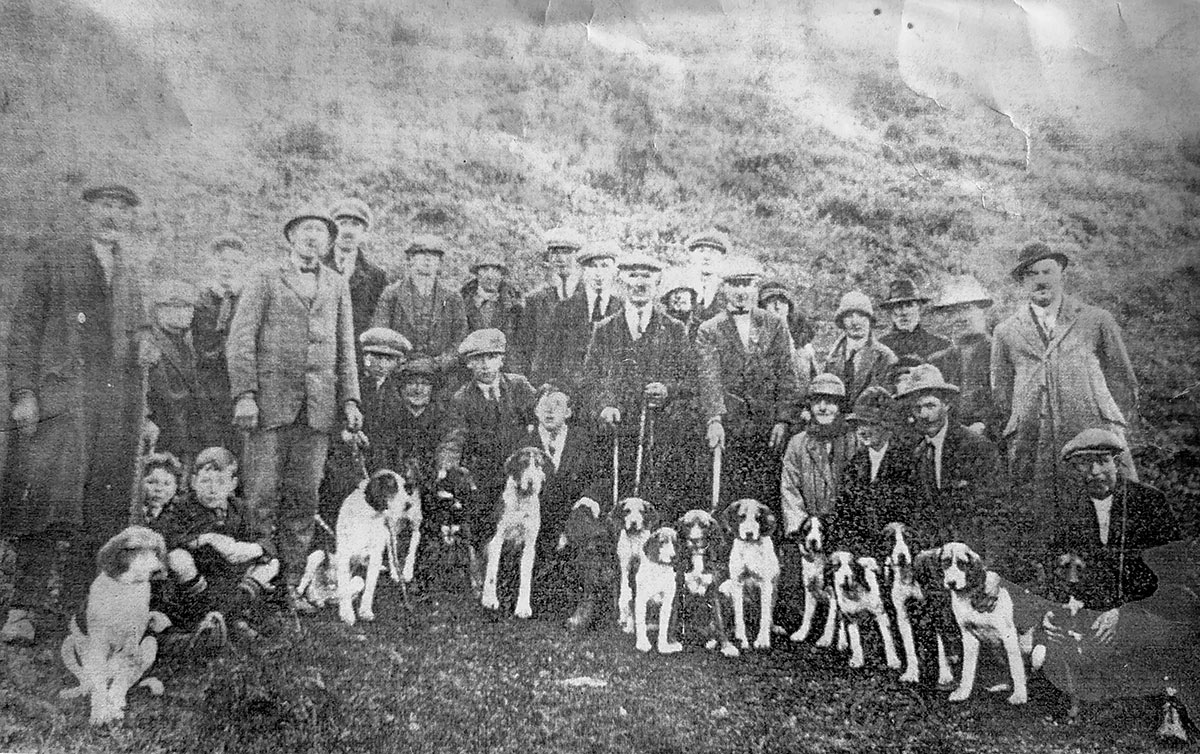 Hunting at Kylatlea. Standing L to R: Jack Roche, (?), John Mockler, Paddy Grace, (?), (?), (?), T. Smith, Bill Boland, Ned Connors, Nonie Shea, Bernie Halloran, Tim Shea (Tubber), Catherine Hogan (née Maher), Cis Tobin, John Costello, Dinny Brien, Nicholas Shea (Cloran). Kneeling in front L to R: John Morrissey, Martin Egan, Pat Morrissey, Mrs Will Freaney, Larry Noonan, Ned Egan, Gertie Shea, Sis Shea, Monty Shea (Anner House) and Mick Brien.
