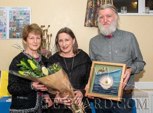 L to R: Mary Healy, Fethard Historical Society, presenting a bouquet to Rita Kenny, and Joe Kenny.