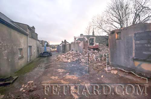 This is Chapel Lane on March 10 this year with the buildings on the right partly demolished. The stone plaque survives on the right hand wall.