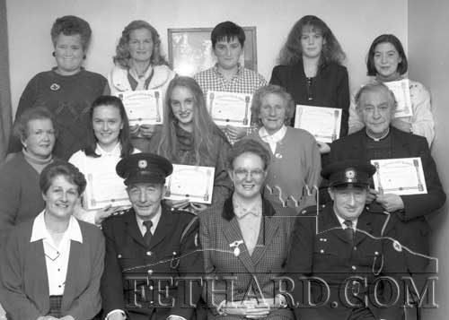 Locals from the Fethard area who completed the Home Nursing Course organised by the local Red Cross branch. These community based nursing courses were pioneered by Nurse Ellen Keane from Tipperary Town who was recently the 34th recipient of the Florence Nightingale medal, the highest award which the International Red Cross can bestow for nursing services. Pictured above with recipients on November 11, 1993 are L to R Front Row: Nell Broderick (course director); Tom McCormack (Area Comdt.); Nurse Ellen Keane; Austin Kenny (Area Captain).