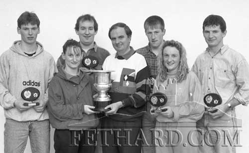 Tullamaine racquetball team, winners of the 'Hayes Cup' racquetball final played at Fethard Sports Centre on December 3, 1993. L to R: Michael Quinlan, Margaret Quinlan, Liam Ryan, Jimmy Hayes (sponsor), Miceál Spillane, Ann Marie Quinlan, and Michael Ryan. Missing from photo is sub, Mary Ryan.