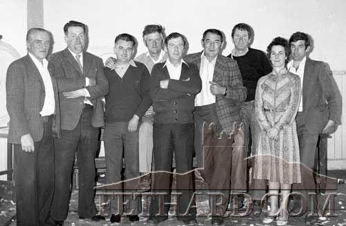 Community Council Committee photographed in the Town Hall after a fundraising auction in aid of the reconstruction of the Tirry Club into a Community Service Centre in 1978. L to R: Mick Ryan, Percy O'Donnell, John Whyte, Tommy Butler, Peter Colville, Malachy Brett, Austin O'Flynn, Nellie Colville and Michael O'Dwyer.