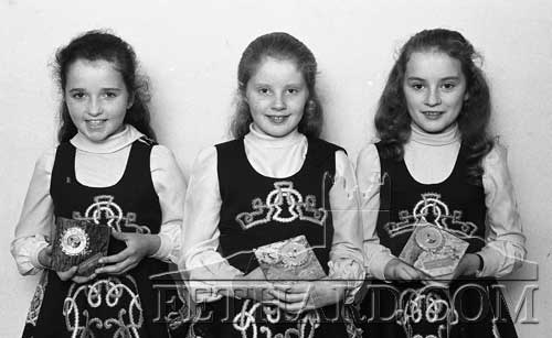 Three girls holding their Clonmel Credit Union trophies for Irish Dancing (October 1981). L to R: Rachel Hickey, Pamela Butler and Debbie Coen.