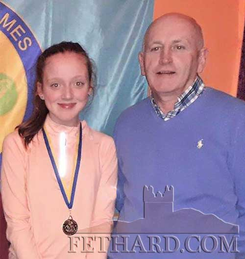 Fiona Barry, Fethard, photographed with Community Games County Chairman, Michael Maher, Fethard, after her outstanding performance to win the U16 Recitation event in Boherlahan last Friday evening, February 28.