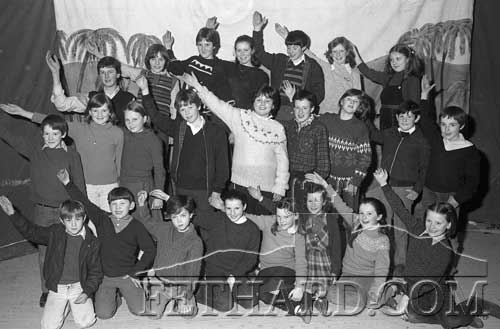 Full group of children on stage at rehearsal for Cloneen School Pantomime 'The Godmother's Capers' that took place in Cloneen Hall on Friday, January 21, and Sunday, January 23, 1983. The show was produced by Shay Ahessy.