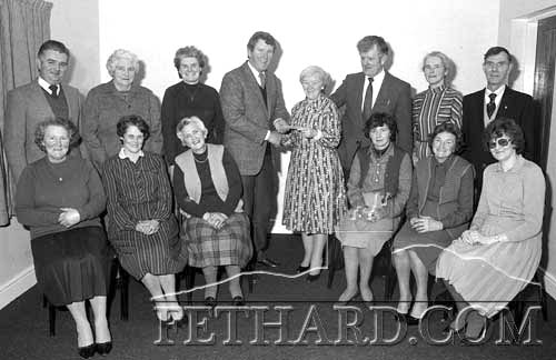 Austin O'Flynn, Chairman Fethard Community Council, making a presentation to the Ladies Catering Committee in January 1983, in recognition of their great work during the year, serving teas at the 25 Drive each week, catering for Supper Dances and running two very successful draws. Back L to R: John Whyte, Nellie Fitzgerald, Margaret Keane, Austin O'Flynn, Kathleen Kenny, Tom Butler, Bridie Hanrahan, Peter Colville. Front L to R: Norah O'Riordan, Maureen Whyte, Mai Carey, Ann Skehan, Babe Maher and Agnes Evans.