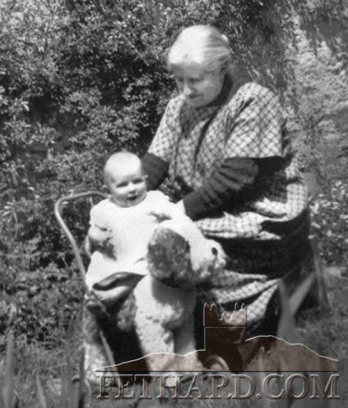 Kate Cantwell, Burke Street, holding her grandchild, Marie McCarthy, a daughter of Peggy (née Cantwell) and Dick McCarthy, Burke Street. Marie later married Donal O'Sullivan, Main Street, Fethard.