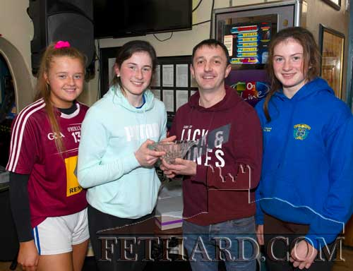 M.J. Croke, representing this month's sponsor Cashel Motors, presenting the Butlers Bar Fethard Sports Achievement Award for January to Lucy Spillane, captain of the Fethard Patrician Presentation Ladies Football Team that won the award. Also included are her team mates, Carrie Davey (left) and Nell Spillane (right).