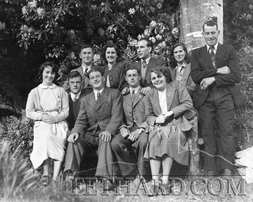 The names we have so far are Back L to R: 'unknown', Bridget Malone, John Collins, Mary Nagle, Thomas 'Buddy' Flannery (Clerihan). Front L to R: Rena Purcell, Tom Butler, Batt Toomey, Willie Slattery and Sheila Power. Can you help identify the last remaining 'unknown' ?