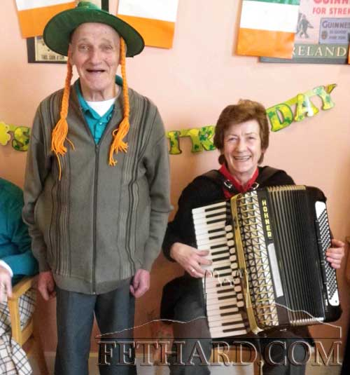 Enjoying St. Patrick's Day in happier times back in 2011, are the late Gus Maher, Friarsgrange, and musician, the late Joan O'Brien, Woodvale Walk, Fethard, photographed at Greenhills Nursing Home in Carrick-on-Suir.