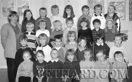 Starting school in Junior Infants class at Nano Nagle Primary School Fethard on September 25, 1998, are Back L to R: Ms. Rita Kenny (teacher), Faye Manton, Dean Sharpe, Eugene Walsh, Mary Anne Fogarty, Tony Myler, Simon Standbridge, Michael Smyth. Third Row: Ronan Fitzgerald, Mary Jane Kearney, Jamie Walsh, Ger Maher, Jane Holohan, Louis Rice, Zoë McManus. Second Row: Ciarán O'Meara, Claire Morrissey, Darren Moloney, Amy Lyons, Ted Barrett, Louise O'Donnell, Brian Delahunty. Front Row L to R: Rachel Prout, Mary Ellen O'Reilly, Garreth Lawrence, Orla Lawrence, Deirdre Dwyer, Jenny Pyke and Gavin Lonergan.